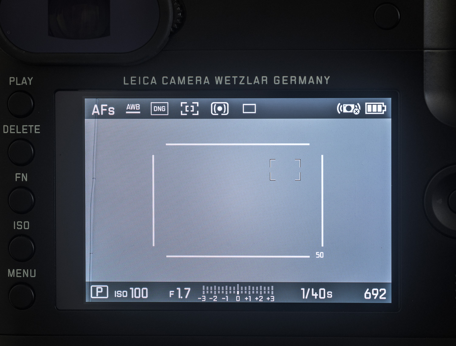 When using the Q in either 35mm or 50mm crop mode with your AF set to  1-point, the auto focus point will stay within the crop marks.