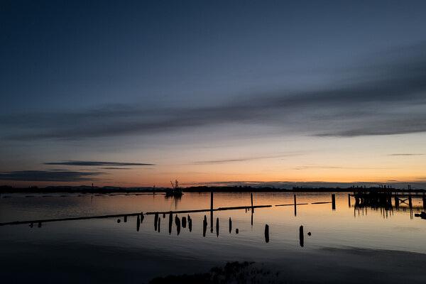 Fishing Boat Returning at Sunset